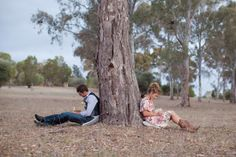 Engagement photo shoot idea. Write a love note to one another, seal and then have the photographer post to you a week before the big day. Love the idea of having backs against a tree.