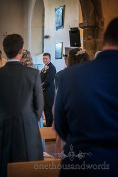 Photograph of grooms first look at bride at church wedding ceremony in Lytchet Matravers in Dorset by one thousand words wedding photography Church Wedding Ceremony, Wedding Venues, Dorset Coast, Mint Bridesmaid Dresses, Wedding Breakfast, Wedding Couples, Newlyweds, Groom, Wedding Photography