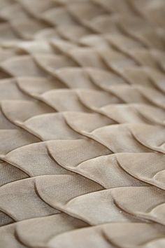 Textiles Design with an elegant use of fold and shape repetition to create textural patterns; fabric manipulation | Amy Pliszka