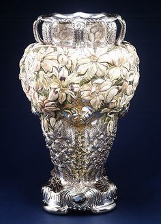 The Magnolia Vase Manufactured by Tiffany & Co, ca. The Magnolia Vase was Tiffany & Company's most prominent silver entry at the Chicago World's Columbian Exposition of In the collection. Art Nouveau, Tiffany Art, Tiffany Glass, Vintage Silver, Antique Silver, Antique Vases, Antique Chandelier, Vintage Vases, Louis Comfort Tiffany