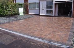 Marshalls Drivesett Tegula Driveway with Lineal Drainage System. http://www.abellandscapes.co.uk/liverpool-driveways