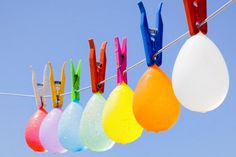 Hanging Colorful Water Balloons. Ask kids to hang water balloons up on the line with the clip. Set the timer to see who can complete this process the first without breaking anyone of them. The kids must feel thrilled to do this and win the champion.