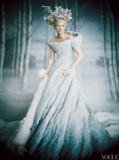 "PALE FIRE Tilda Swinton, in costume as the White Witch in a pale-blue felt dress and white fox fur stole. As the witch's power wanes, her costumes get smaller and her ""icicles"" in her headdress melt. Photographed by Paolo Roversi, Vogue, December 2005"