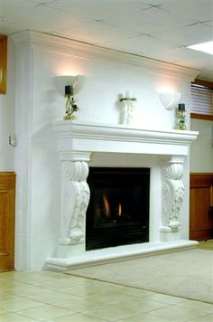 A white cast stone mantel will make any fireplace the focal point of your room.  http://www.mantelsdirect.com/cast_stone/majestic_series/seville-stone-fireplace-mantel.html