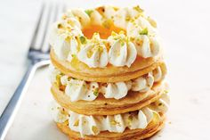 <strong>Mille-feuille is a classic French dessert with three layers of puff pastry. In this version, we've substituted the traditional custard with whipped cream and lemon curd for a tangy twist. You'll find jars of lemon curd in the jam section of most grocery stores. </strong>