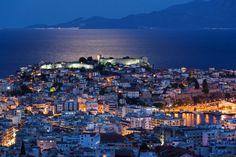 The serene night scene of Kavala, Greece.