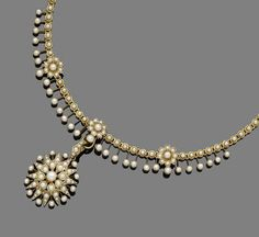 A late 19th century pearl necklace The pearl floral fringe necklace, suspending a detachable similarly-set starburst pendant, pendant engraved '1870. 31 March. 1910'