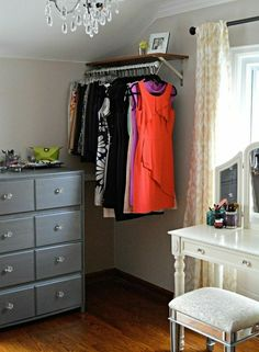 furniture for small spaces Inexpensive dress room. Check out this gorgeous converted bedroom makeover--- vanity in front of window, vintage lighting, garment racks, small dresser w/ vanity tray, build in laundry sorter Room Closet, Closet Space, Corner Closet, Attic Closet, Closet Desk, Corner Rack, Wardrobe Room, Closet Tour, Closet Office