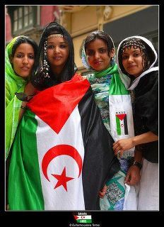 -Women from WesternSahara holding the flag of their country which is still in exile..