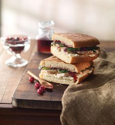 New Roasted Turkey & Cranberry Panini at Panera Bread: All-natural roasted turkey, garlic & herb cheese spread, zesty cranberry mostarda (cranberry chutney), and fresh spinach on fresh baked artisan Ciabatta.