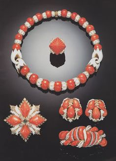 Yellow gold, coral and enamel parure.  Image Sotheby's