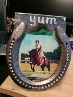Horseshoe craft that I made with an used horseshoe, crystal chain, and a clear picture frame.