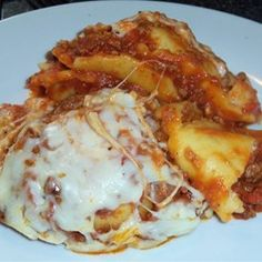 A fantastic way to enjoy lasagna without all the fuss! I thought using frozen ravioli already filled with cheese instead of layering layers of noodles and cheese would make a great dish so easy. It all comes together