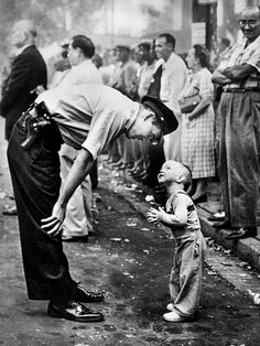 "The 1958 Pulitzer Prize Winner in Photography - William C. Beall of Washington (DC) Daily News For his photograph - "" Faith and Confidence, "" showing a policeman patiently reasoning with two-year-old boy trying to cross a street during a parade. September 10, 1957"