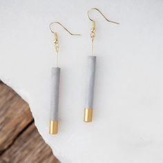 Industrial materials and classic flair play together in these lightweight concrete cylinder earrings. Can be layered with other gold accessories, or worn alone for a unique modern look. Pairs nicely w Concrete Jewelry, Ceramic Jewelry, Polymer Clay Jewelry, Concrete Bar, Ceramic Necklace, Porcelain Jewelry, Fine Porcelain, Diy Jewelry, Jewelery