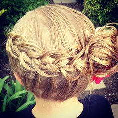 Dutch braid with feathered accents to a messy bun. #twinshair #cutegirlshairstyles  http://youtu.be/BWO_MUiVchQ