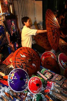 Umbrella Vendor, Chiang Mai, Thailand. I would love to decorate an entire wall with the tops of umbrellas in all different sizes.