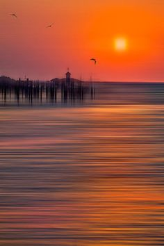 Peaceful sunrise at Southport North Carolina in a surreal painted style.  Dan Carmichael.