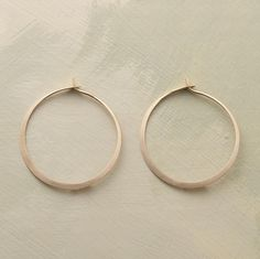 """Melissa Joy Manning coaxes a continuous length of 14kt gold into a gently curved self-locking hoop. Hand forged in USA. 1-1/8"""" dia."""