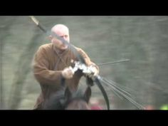 A perfect shot: Hungarian archer and boyer Lajos Kassai shoots 12 arrows in just 18 seconds.