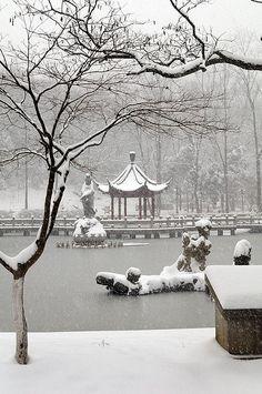 Snow falling on a beautiful Pagoda in Qi Xia temple, Nanjing, China