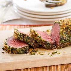 Herb-Crusted Beef Tenderloin    Serves 12 to 16    Make sure to begin this recipe 2 hours before you plan to put the roast in the oven. The tenderloin can be trimmed, tied, rubbed with the salt mixture, and refrigerated up to 24 hours in advance; make sure to bring the roast back to room temperature before putting it into the oven.    INGREDIENTS  1whole beef tenderloin (5 to 6 pounds), trimmed and patted dry    Kosher salt and cracked black pepper  2teaspoons sugar  2slices hearty white sandwich bread, torn into pieces  1/2cup chopped fresh parsley leaves  2teaspoons chopped fresh thyme leaves, plus 2 tablespoons  1 1/4cups Grated Parmesan cheese  6tablespoons olive oil  4 garlic cloves, minced  INSTRUCTIONS  1. Tuck tail of tenderloin under and tie roast. Combine 1 tablespoon salt, 1 tablespoon pepper, and sugar in small bowl and rub all over tenderloin. Transfer tenderloin to wire rack set on rimmed baking sheet and let stand at room temperature for 2 hours.    2. Meanwhile, pulse bread in food processor to fine crumbs. Transfer bread crumbs to medium bowl and toss in 2 tablespoons parsley, 2 teaspoons thyme, 1/2 cup Parmesan, and 2 tablespoons oil until evenly combined. Wipe out food processor and process remaining 6 tablespoons parsley, 2 tablespoons thyme, 3/4 cup cheese, 4 tablespoons oil, and garlic until smooth paste forms. Transfer herb paste to small bowl.    3. Adjust oven rack to upper-middle position and heat oven to 400 degrees. Roast tenderloin 20 minutes and remove from oven. Using scissors, cut and remove twine (photo 2). Coat tenderloin with herb paste followed by bread-crumb topping (photos 3 and 4). Roast until thickest part of meat registers about 130 degrees (for medium-rare) and topping is golden brown, 20 to 25 minutes. (If topping browns before meat reaches preferred internal temperature, lightly cover with foil for balance of roasting time and remove while roast rests.) Let roast rest, uncovered, for 30 minutes on wire rack. Transfer to cutting board and carve. Serve.    SECRETS TO HERB-CRUSTED BEEF TENDERLOIN    1. To ensure even cooking, fold the thin, tapered end under the roast, then tie the entire roast with kitchen twine every 1 1/2 inches.      2. After the meat has cooked for 20 minutes, use scissors to snip the twine and carefully pull the strings away from the tenderloin.      3. Using a spatula, spread the herb paste evenly over the top and sides of the tenderloin.      4. Press the bread-crumb mixture evenly onto the roast, using the other hand to catch the crumbs and keep them from falling through the rack.