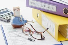 clean insurance form folders pen piggy bank and calculator