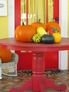 Red pedestal table on the porch!