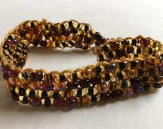 Check out Brown bronze yellow peyote stitch beaded bracelet,gift for her, birthday gift, sunburst bracelet, button jewelry, weaved bracelet ,handmade on dawnsbeadsdesigns