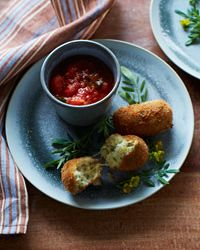 Potato-and-Mozzarella Croquettes Recipe on Food & Wine: These light and cheesy fried potato croquettes are breaded twice: They're dredged in bread crumbs, dipped in beaten eggs seasoned with mustard and garlic, then dredged in bread crumbs once more. The payoff is a supercrisp, flavorful crust for the filling of soft mashed potato and melted cheese.