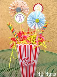 Circus and Carnival Party - Pinwheels, centerpieces, etc Buy pinwheels and popcorn containers for food table. (Target).