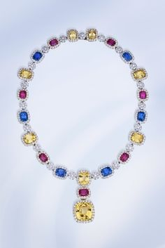 Samuel Getz  Samuel Getz Designs  Miami, FL USA    Platinum and 18K yellow gold necklace featuring yellow Sapphires (68.77 ctw.), blue Sapphires (24.34 ctw.), red Spinels (24.20 ctw.) and Diamonds (22.38 ctw.).