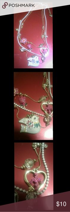 🐠Betsey Johnson necklace🐠 Three chain adorable necklace, pretty birds and hearts, diamonds and peace sign and cute dove pendant. Jewelry Necklaces