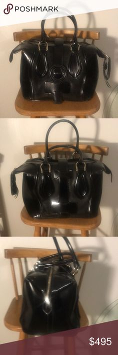 "BALENCIAGA AUTH! Rare patent/suede large handbag BALENCIAGA AUTHENTIC, Rare, sold out everywhere!! Black patent & suede leather, large, structured, satchel / duffle / doctor Back handbag. EUC! No flaws. Maybe a few spots on the suede with are flattened a tad and that's it! Missing the hang tag. Silver hardware. Huge amount of room! You could fit a bowling ball in there! W:12.5"" H:10"" D:9"", strap drop: 8"" Balenciaga Bags"