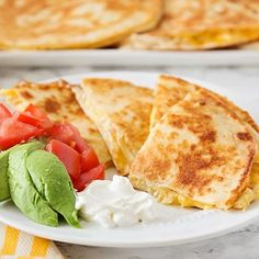 Easy Cheesy Chicken Quesadilla Recipe - Somewhat Simple- A no-stress meal for a busy weeknight dinner, this cheesy chicken quesadilla recipe is simple and delicious! Cheesy Chicken Quesadilla Recipe, Pulled Pork Quesadilla, Chicken Quesadillas, Easy Chicken Recipes, Easy Healthy Recipes, Gourmet Recipes, Easy Meals, Healthy Menu
