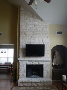 These customers loved their fireplace after we took out their wood mantle and customized it with limestone.