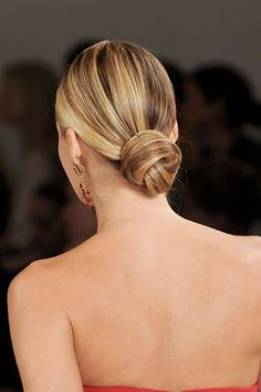 Give a simple bun a prom-worthy upgrade. Comb hair into a slick low pony, then separate into two sections and twist together. Mke a bun for a folded look.