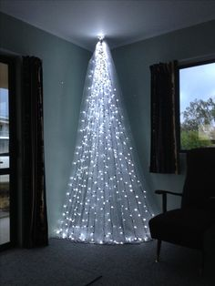 Top 6 Alternative Christmas Tree Ideas - DIAMOND INTERIORS - - Short on space? Try these stunning alternative Christmas tree ideas to WOW this Christmas! Different Christmas Trees, Wall Christmas Tree, Creative Christmas Trees, Beautiful Christmas Trees, Modern Christmas, Simple Christmas, Christmas Home, Christmas Holidays, Christmas Crafts