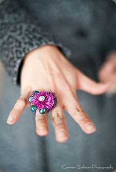 Fresh flower corsage ring for prom - lots of bling for such a small thing. :) Long-lasting blossoms such as the button pompom shown are perfect for these.