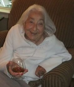 Mom Loved Her Zippered Robes With Pockets In Front - Good Gifts For Senior Citizens. That's Mom with her sherry at happy hour, wearing her favorite robe.