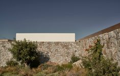The Greek architecture practice K-Studio has recently completed Villa Mandra, a single-family home located on the hill of Aleomandra in Mykonos, Greece. #villa #mykonos #pool #greece #stone #stonehouse #architecture #architect #amazingarchitecture #design #interiordesign #interiordesigner #decor #homedecor #home #house #luxury #diy #travel #amazing #photography #realestate #casa #arquitecto #arquitectura #decoration #greekisland #aegansea #sea #nature #desert #swimmingpool #houseplan Studio Build, Wooden Pergola, House Built, Deco, Photo Studio, Villa, Photo And Video, Landscape, Gallery