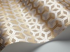 Cole and son honeycomb  wallpaper in back of bookcases