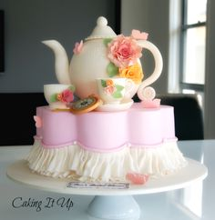 Exquisite Teapot and Tea Cup petal cake. All handmade and edible.  www.facebook.com/cakingitup