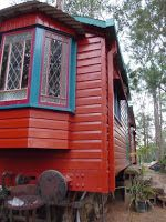 Small Maroon Train House Minimalist Design Make a Artistic Masterpiece