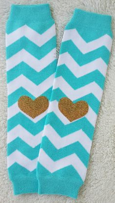 Theseturquoise chevron baby, toddler, & kid girlleg warmers are just the best!Adorned with gold glitter heart patches, they look absolutely adorable both slouchy or stretched straight. These leggings are excellent for babies in ALL seasons!
