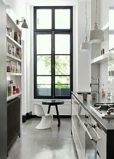 black windowsill in a galley kitchen.