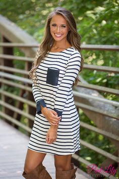 This sweet striped dress is the perfect way to cross between summer and fall! We adore the beautiful nautical prep vibes of the navy and white stripes - it's such a classic look that transcends seasons!