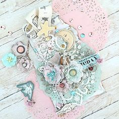Scrapbooking mixmedia tag with Prima Marketing Chipboards, handmade paper flowers, lace . Shabby chic romantic style and light colours.