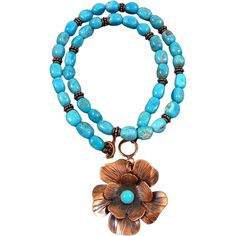 Beautiful and feminine Copper flowers that I cut, etched and soldered together with an 8mm turquoise cabochon center. This lovely flower hangs below a 20 inch Kingman turquoise beaded necklace with a front toggle clasp. This necklace will be sure to bring compliments wherever you wear it.