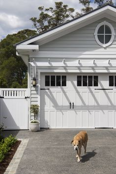 A neutral colour palette and Scyon Linea weatherboards are key for achieving a modern coastal look. Garage Door Styles, Wood Garage Doors, Garage Door Design, Detached Garage Designs, White Garage Doors, Garage Exterior, Carport Garage, Exterior Paint, Exterior Homes